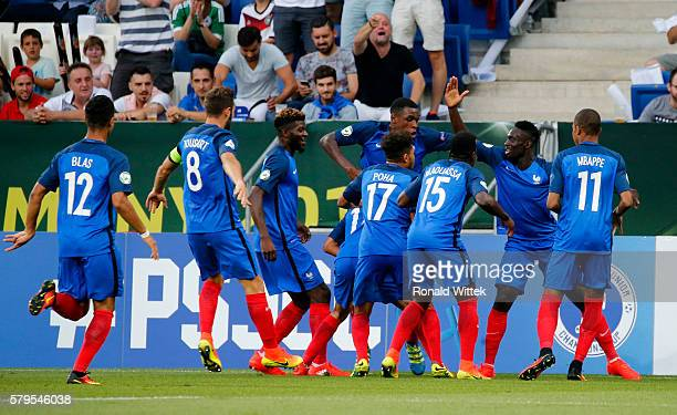JeanKevin Augustin of France celebrates after scoring his team's first goal with his teammates during the UEFA Under19 European Championship Final...