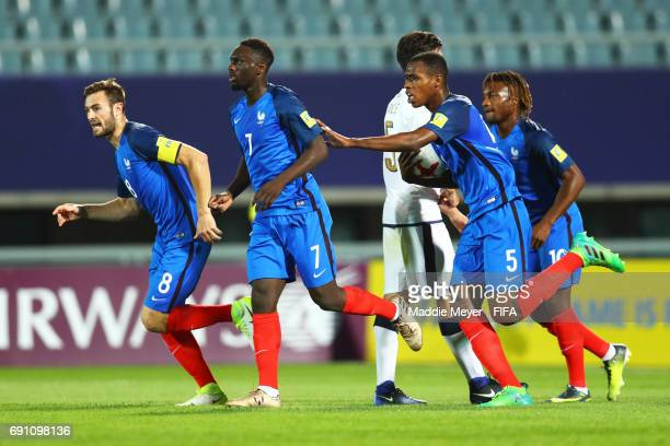 JeanKevin Augustin of France celebrates with Lucas Tousart and Issa Diop after scoring off of a penalty kick during the FIFA U20 World Cup Korea...