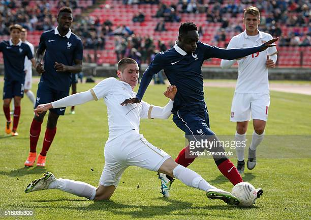 JeanKevin Augustin of France in action against Nikola Milenkovic of Serbia during the UEFA European U19 Championship Elite Round Group 7 match...