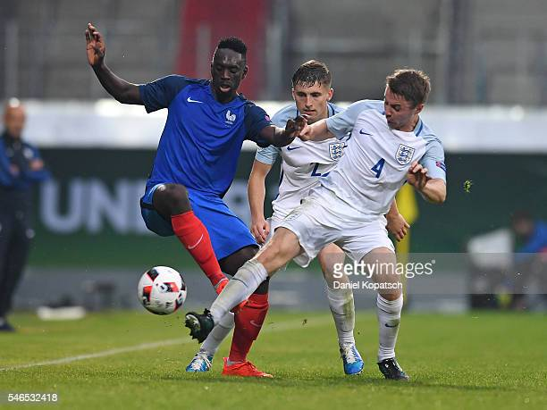 JeanKevin Augustin of France is challenged by Jordan Rossiter of England during the UEFA Under19 European Championship match between U19 France and...
