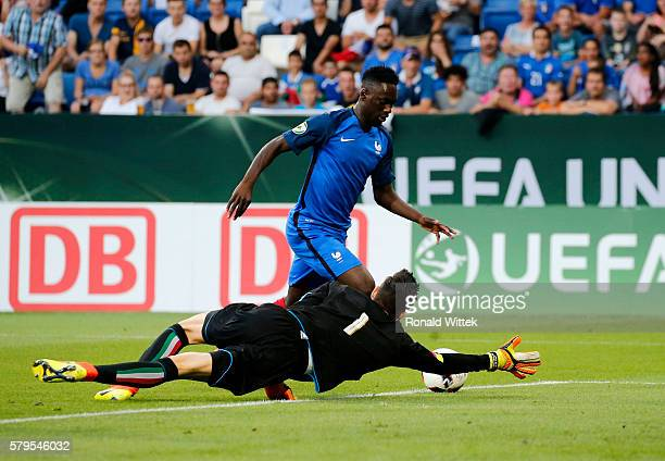 JeanKevin Augustin of France scores his team's first goal against Goalkeeper Alex Meret of Italy during the UEFA Under19 European Championship Final...
