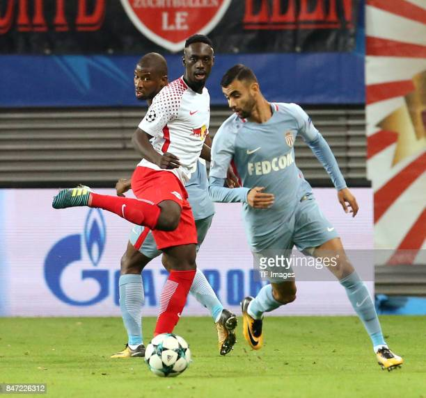 JeanKevin Augustin of Leipzig and Rachid Ghezzal of Monaco battle for the ball during the UEFA Champions League group G match between RB Leipzig and...
