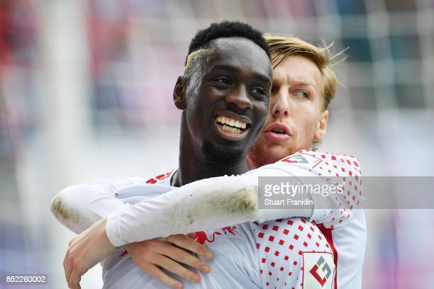 JeanKevin Augustin of Leipzig celebrates after he scored his team first goal to make it 10 with Emil Forsberg of Leipzig during the Bundesliga match...