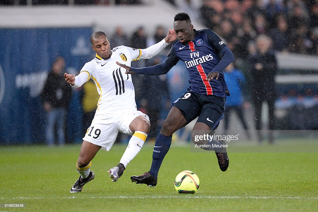 Jean-Kevin Augustin of Paris Saint-Germain and Djibril Sidibe of Lille OSC fight for the ball during the Ligue 1 game between Paris Saint-Germain and Lille OSC at Parc des Princes on February 13, 2016 in Paris, France.
