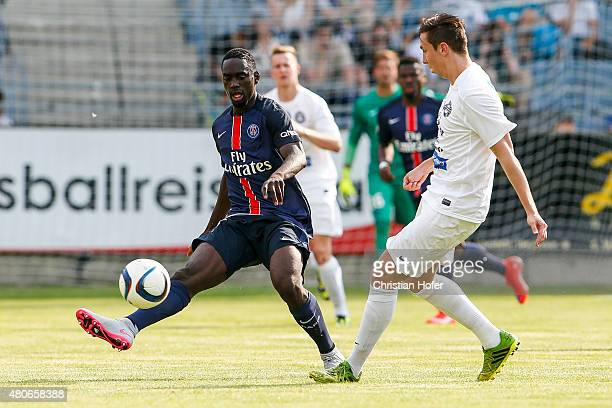 JeanKevin Augustin of Paris SaintGermain competes for the ball with Christoph Hevera of Wiener Sportklub during the Friendly Match between Wiener...