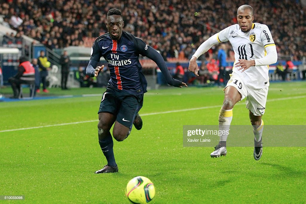 Jean-Kevin Augustin of Paris Saint-Germain in action with <a gi-track='captionPersonalityLinkClicked' href=/galleries/search?phrase=Djibril+Sidibe&family=editorial&specificpeople=2536469 ng-click='$event.stopPropagation()'>Djibril Sidibe</a> of Lille LOSC during the French Ligue 1 between Paris Saint-Germain and Lille OSC at Parc Des Princes on february 13, 2016 in Paris, France.