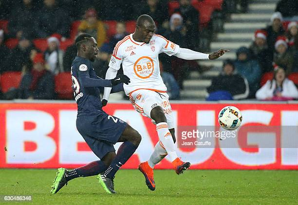JeanKevin Augustin of PSG and Zargo Toure of Lorient in action during the French Ligue 1 match between Paris SaintGermain and FC Lorient at Parc des...
