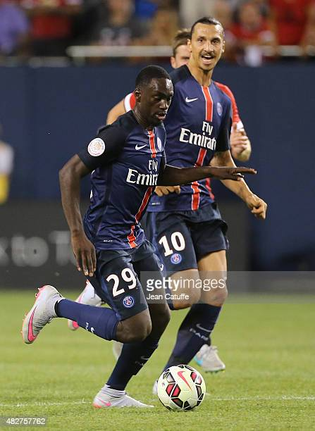 JeanKevin Augustin of PSG and Zlatan Ibrahimovic of PSG in action during the International Champions Cup 2015 game between Manchester United and...