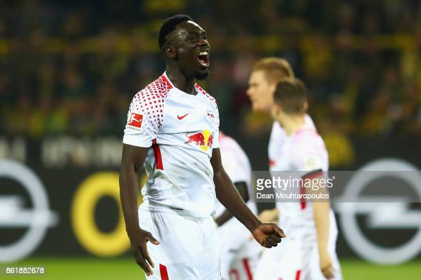 JeanKevin Augustin of RB Leipzig celebrates scoring his teams third goal of the game during the Bundesliga match between Borussia Dortmund and RB...
