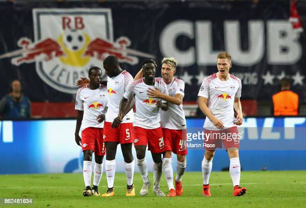 JeanKevin Augustin of RB Leipzig celebrates with team mates after scoring during the UEFA Champions League group G match between RB Leipzig and FC...