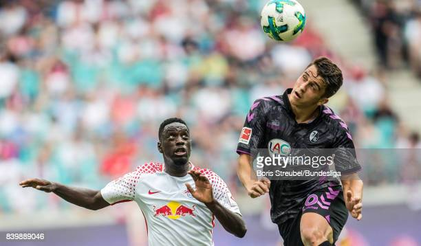 JeanKevin Augustin of RB Leipzig jumps for a header with MarcOliver Kempf of SC Freiburg during the Bundesliga match between RB Leipzig and SportClub...