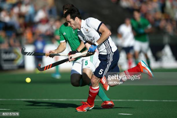 JeanLaurent Kieffer of France and Matthew Bell of Ireland battle for possession during the 5th8th place play off match between Ireland and France on...