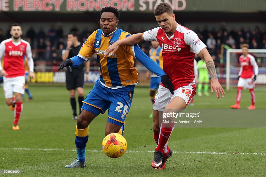 Jean-Louis Akpa Akpro of Shrewsbury Town and Tyler Forbes of Fleetwood Town during the Sky Bet League One match between Fleetwood Town and Shrewsbury Town at Highbury Stadium on February 7, 2016 in Fleetwood, England.