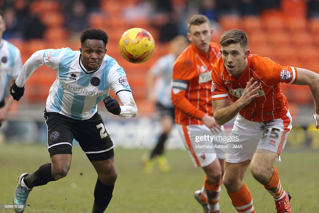 Jean-Louis Akpa Akpro of Shrewsbury Town and Will Aimson of Blackpool during the Sky Bet League One match between Blackpool and Shrewsbury Town at Bloomfield Road on February 13, 2016 in Blackpool, England.