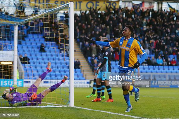 JeanLouis Akpa Akpro of Shrewsbury Town celebrates scoring his team's first goal during the Emirates FA Cup Fourth Round match between Shrewsbury...