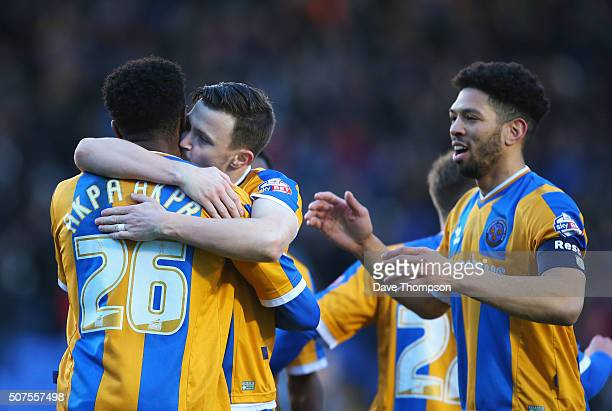 JeanLouis Akpa Akpro of Shrewsbury Town celebrates scoring his team's first goal with his team mate Andrew Mangan during the Emirates FA Cup Fourth...