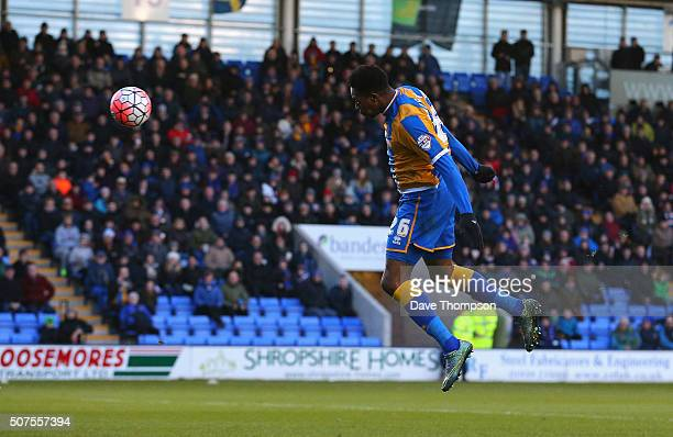 JeanLouis Akpa Akpro of Shrewsbury Town heads to score his team's first goal during the Emirates FA Cup Fourth Round match between Shrewsbury Town...
