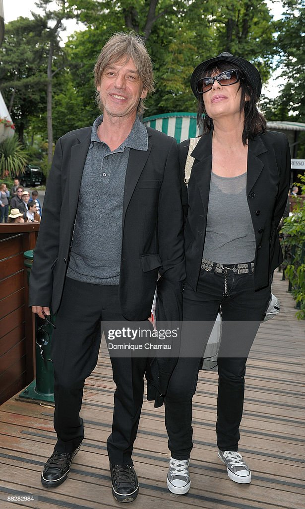 Jean-louis Aubert and Guest attend The French Open 2009 at Roland Garros Stadium on June 7, 2009 in Paris, France.
