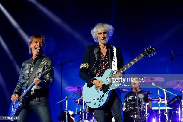 JeanLouis Aubert and Louis Bertignac from French band Les Insus perform on the stage at the Stade de France on September 15 2017 in SaintDenis near...