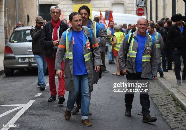 JeanLouis Borie lawyer of employees of French auto parts manufacturer GMS arrives with GMS employees at the trade court of Poitiers central France on...