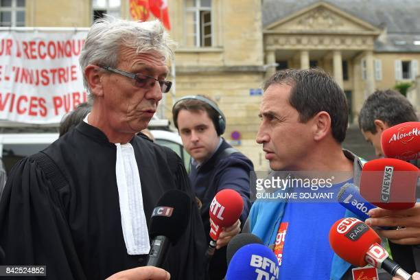 JeanLouis Borie lawyer of employees of French auto parts manufacturer GMS and CGT workers' union representative Vincent Labrousse speak to the press...