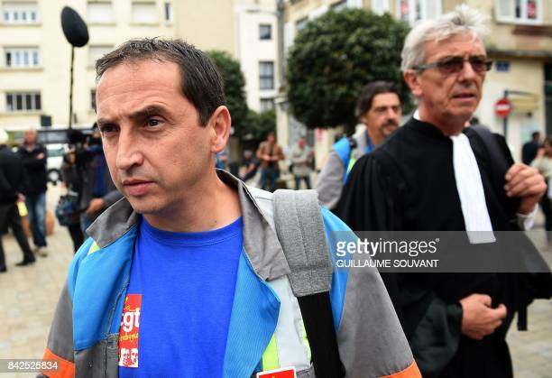 JeanLouis Borie lawyer of employees of French auto parts manufacturer GMS and CGT workers' union representative Vincent Labrousse leave the trade...