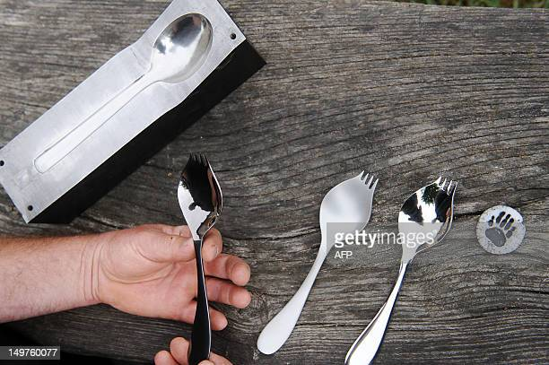 JeanLouis Orengo a French trapper and animal tracks expert holds the 'Georgette' a spoon which is both a fork and a knife on August 3 2012 in the...