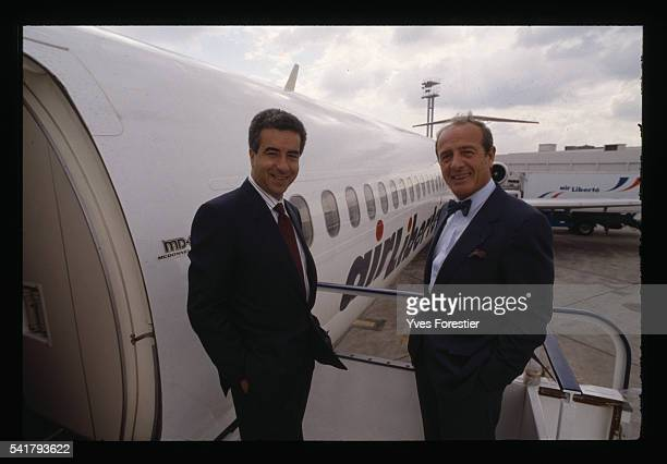 JeanLouis Petriat and Lotfi Belhassine heads of Air Liberte airlines in front of one of their aircraft