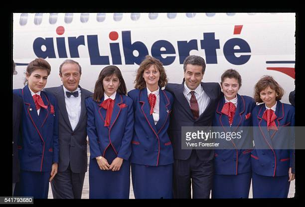 JeanLouis Petriat and Lotfi Belhassine heads of Air Liberte airlines with stewardesses in front of one of their aircraft