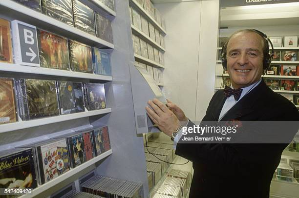 JeanLouis Petriat CEO of Fnac listens to music at the opening of the new Fnac Etoile store in Paris France Fnac distributes cultural goods such as...