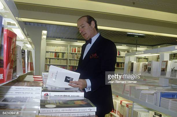 JeanLouis Petriat CEO of Fnac reads a book at the opening of the new Fnac Etoile store in Paris France Fnac distributes cultural goods such as...