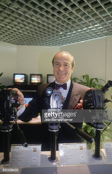 JeanLouis Petriat CEO of Fnac stands with a display of camcorders at the opening of the new Fnac Etoile store in Paris France Fnac distributes...