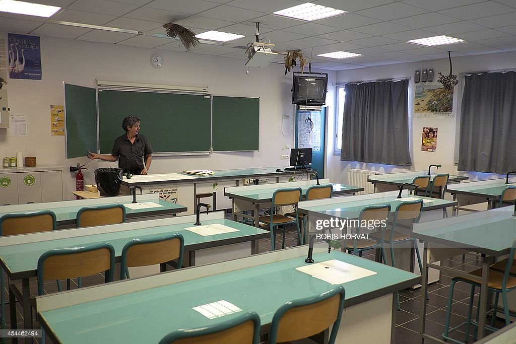 Jean-Louis Toucas, natural sciences' teacher at the college du Roy d'Espagne, prepares his classroom in Marseille, southern France, on September 1, 2014, on the eve of the new school year.
