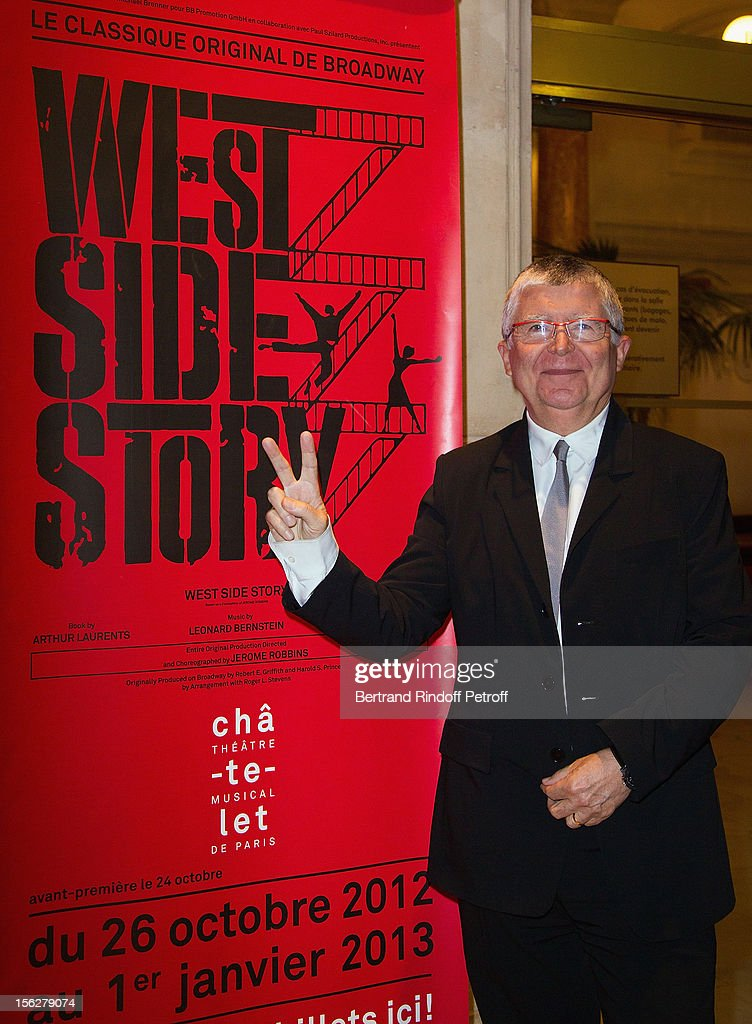 Jean-Luc Choplin, Director General of the Chatelet Theater, reacts as he poses next to a poster announcing classic musical West Side Story, as he attends the Gala de l'Espoir charity event against cancer at Theatre du Chatelet on November 12, 2012 in Paris, France.