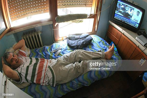 JeanLuc from Tunisia watches television in one of the six Via Anelli apartment blocks on July 17 2007 in Padua northern Italy JeanLuc is one of the...