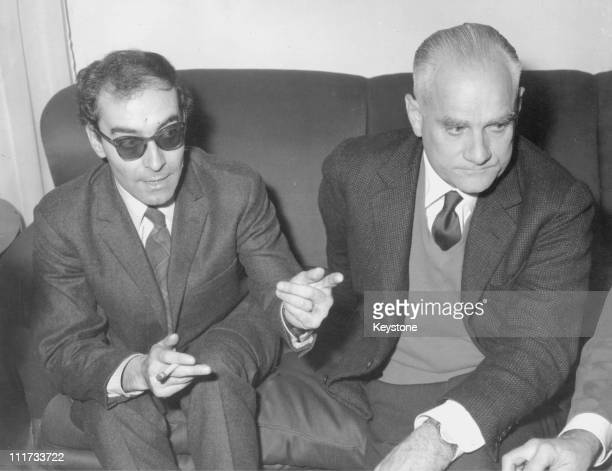JeanLuc Godard director of the film 'Le Mepris' and Alberto Moravia the Italian writer on whose novel the film is based during a press conference in...