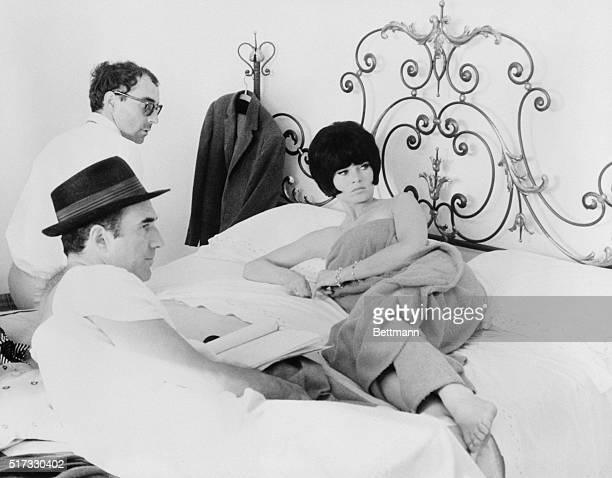 JeanLuc Godard discusses a bedroom scene with Brigitte Bardot and Michel Piccoli on the set of Le Mepris