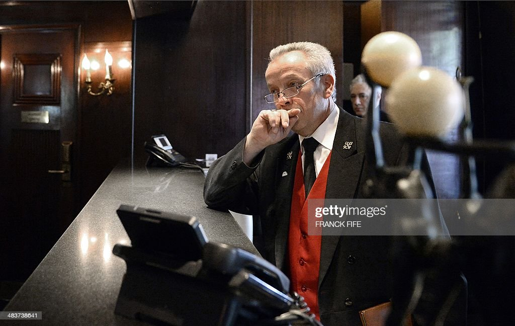 Jean-Luc Jean, who has worked as a concierge for 44 years at the luxury hotel 'Lutetia' in Paris, stands in the lobby of the hotel on April 10, 2014. The hotel, built in 1910 by French architects Louis-Charles Boileau and Henri Tauzin, will close its doors on April 14, 2014, prior to a total renovation. Throughout the years, various celebrities stayed at the 'Lutetia', such as French author and winner of the Nobel Prize in Literature in 1947 Andre Gide, American-born French actress Josephine Baker and French General Charles de Gaulle on the occasion of his wedding night. AFP PHOTO / FRANCK FIFE