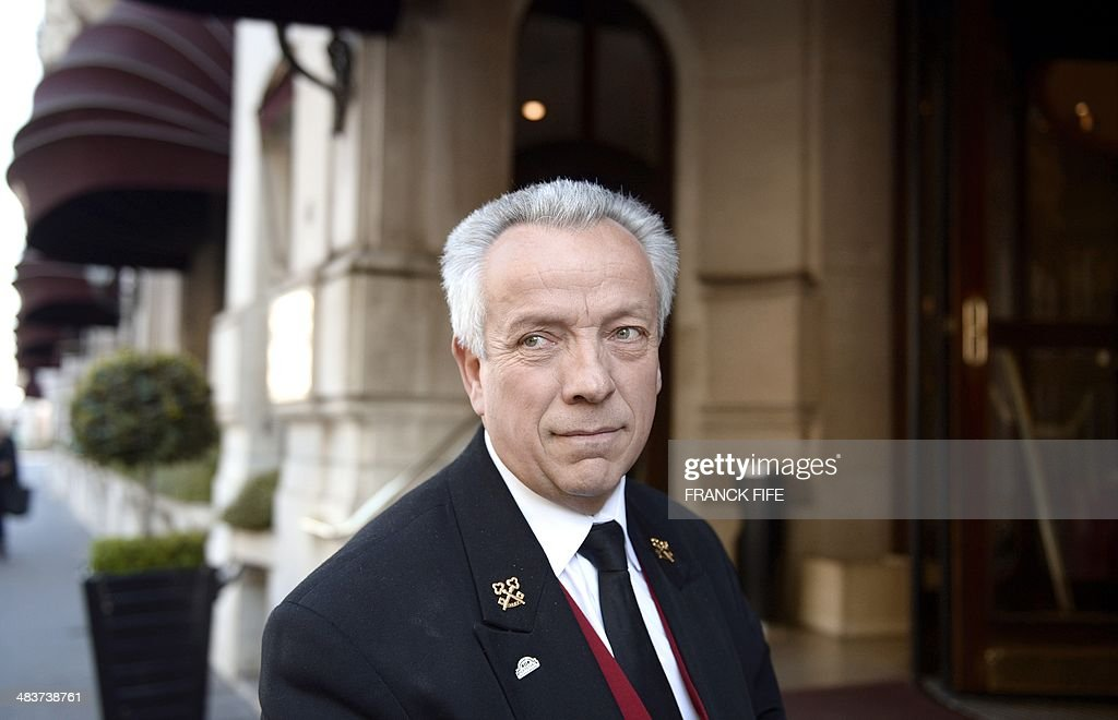 Jean-Luc Jean, who has worked as a concierge for 44 years at the luxury hotel 'Lutetia' in Paris, poses outside the hotel on April 10, 2014. The hotel, built in 1910 by French architects Louis-Charles Boileau and Henri Tauzin, will close its doors on April 14, 2014, prior to a total renovation. Throughout the years, various celebrities stayed at the 'Lutetia', such as French author and winner of the Nobel Prize in Literature in 1947 Andre Gide, American-born French actress Josephine Baker and French General Charles de Gaulle on the occasion of his wedding night.