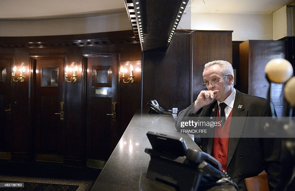 Jean-Luc Jean, who has worked as a concierge for 44 years at the luxury hotel 'Lutetia' in Paris, stands in the lobby of the hotel on April 10, 2014. The hotel, built in 1910 by French architects Louis-Charles Boileau and Henri Tauzin, will close its doors on April 14, 2014, prior to a total renovation. Throughout the years, various celebrities stayed at the 'Lutetia', such as French author and winner of the Nobel Prize in Literature in 1947 Andre Gide, American-born French actress Josephine Baker and French General Charles de Gaulle on the occasion of his wedding night.