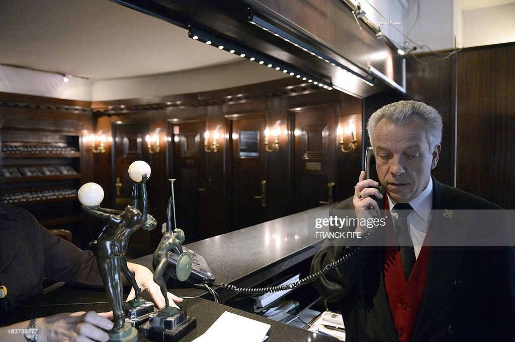 Jean-Luc Jean, who has worked as a concierge for 44 years at the luxury hotel 'Lutetia' in Paris, speaks on the phone in the lobby of the hotel on April 10, 2014. The hotel, built in 1910 by French architects Louis-Charles Boileau and Henri Tauzin, will close its doors on April 14, 2014, prior to a total renovation. Throughout the years, various celebrities stayed at the 'Lutetia', such as French author and winner of the Nobel Prize in Literature in 1947 Andre Gide, American-born French actress Josephine Baker and French General Charles de Gaulle on the occasion of his wedding night.
