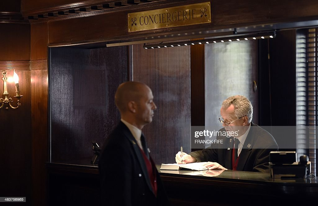 Jean-Luc Jean, who has worked as a concierge for 44 years at the luxury hotel 'Lutetia' in Paris, stands at this desk in the lobby of the hotel on April 10, 2014. The hotel, built in 1910 by French architects Louis-Charles Boileau and Henri Tauzin, will close its doors on April 14, 2014, prior to a total renovation. Throughout the years, various celebrities stayed at the 'Lutetia', such as French author and winner of the Nobel Prize in Literature in 1947 Andre Gide, American-born French actress Josephine Baker and French General Charles de Gaulle on the occasion of his wedding night.