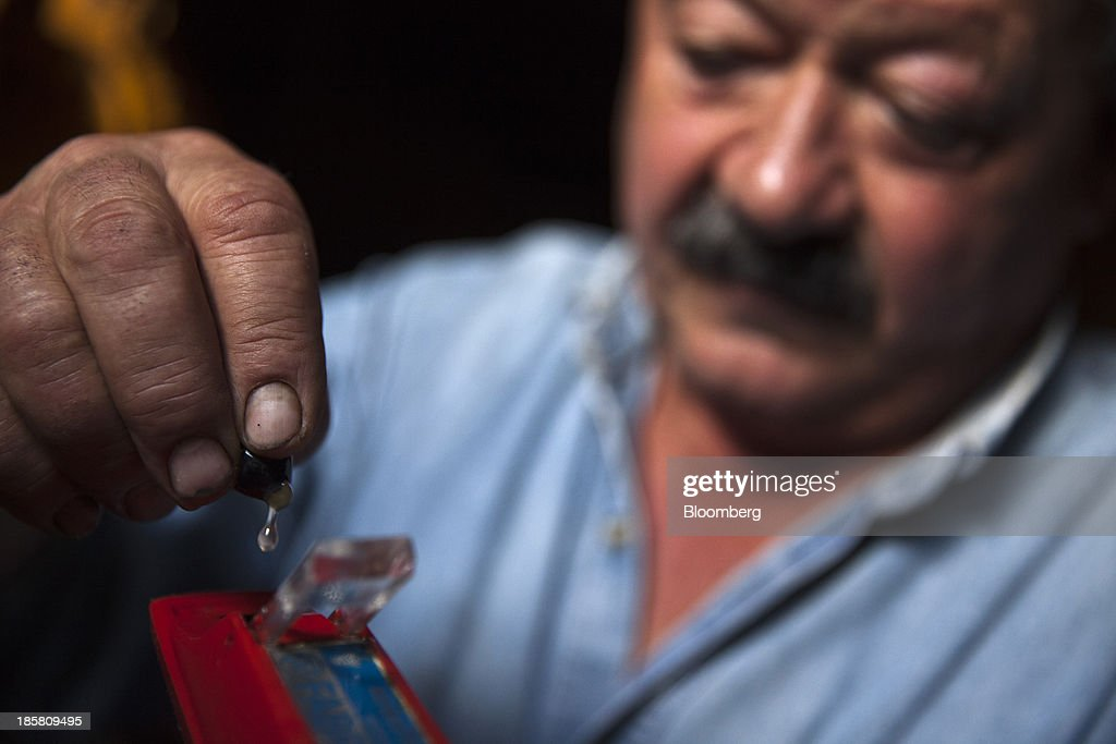 Jean-Luc Matha, a winemaker and owner of the Jean-Luc Matha vineyard, uses an oechsle scale to measure a grape's must density during the harvest in Clairvaux, France, on Thursday, Oct. 24, 2013. France's stocks of wine fell to the lowest in at least 12 years after the country's production plunged 19 percent last year, crop office FranceAgriMer said. Photographer: Balint Porneczi/Bloomberg via Getty Images