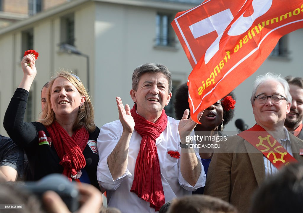 Jean-Luc Melenchon (C), leader of Front de Gauche (Left Front) left wing party applauds beside Christian Picquet (R), spokesman of the French far-leftist party Gauche Unitaire (GU) as they take part in a demonstration at Melenchon's call on May 5, 2013 in Paris, called by Jean-Luc Melenchon, leader of Front de Gauche (Left Front) left wing party, to protest 'against the austerity, against the finance and to ask for a Sixth Republic'. When France's president Francois Hollande swept to power on May 2012 on a wave of discontent, he could hardly have imagined that a year later he would be the most unpopular president in modern French history.
