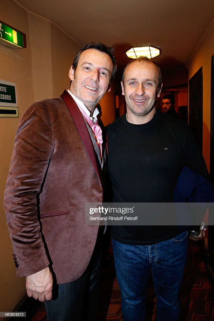 Jean-Luc Reichmann and France Rugby Team Trainer Philippe Saint Andre attend France Rugby Team for '2015, 6 Nations Tournament' is Guest of Honor at Hibernatus Theater Play on January 31, 2015 in Paris, France.