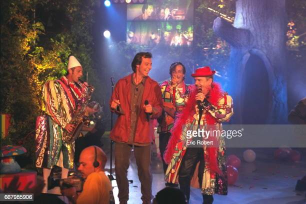 JeanLuc Reichmann and Ticky Holgado with his band the Clapshooters