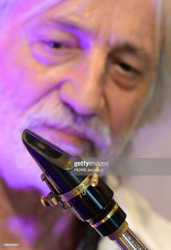 Jean-Luc Vignaud, winner of the 2013 Concours Lepine (Lepine contest), poses with his invention, a brass ligature aimed at adjusting the reed of a saxophone or a clarinet in order to preserve the sound, during the Paris' Fair at the Porte de Versailles exhibition hall in Paris, on May 11, 2013. The competition was launched in 1901 by Louis Lepine, the city's police chief. ANDRIEU