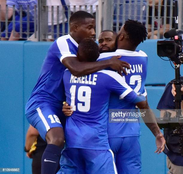 JeanManuel Nedra Daniel Herelle and Yoann Arquin of Martinique congratulate teammate Kevin Parsemain on scoring a goal against Nicaragua during the...