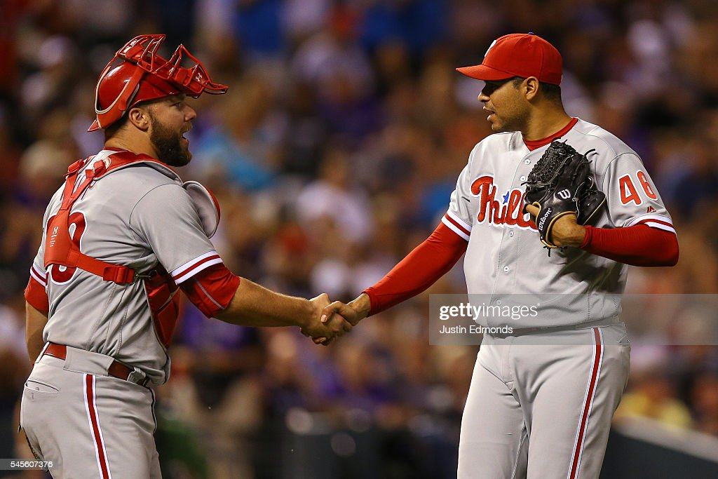 Jeanmar Gomez #46 of the Philadelphia Phillies is congratulated by catcher Cameron Rupp #29 after their win against the Colorado Rockies at Coors Field on July 8, 2016 in Denver, Colorado. The Phillies defeated the Rockies 5-3.