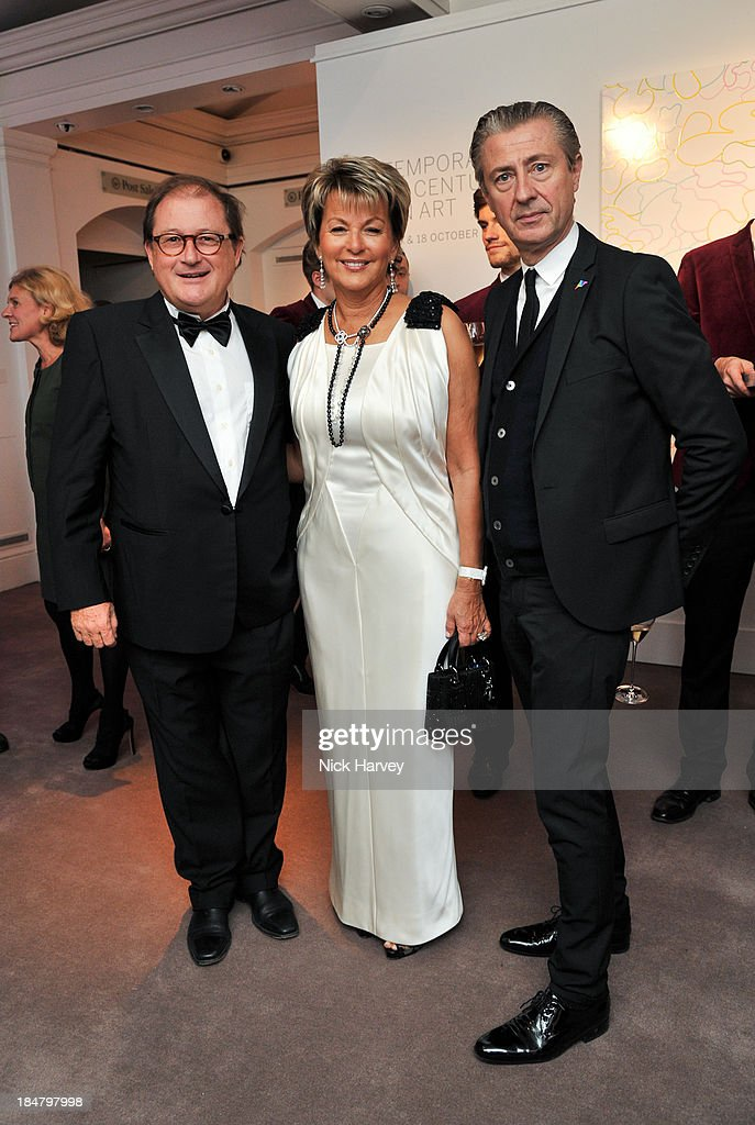 Jean-Marc Decrop, Myriam Ullens and Jerome Sans attend Mimi Foundation 'The Power of Love' gala dinner and auction at Sotheby's on October 16, 2013 in London, England.